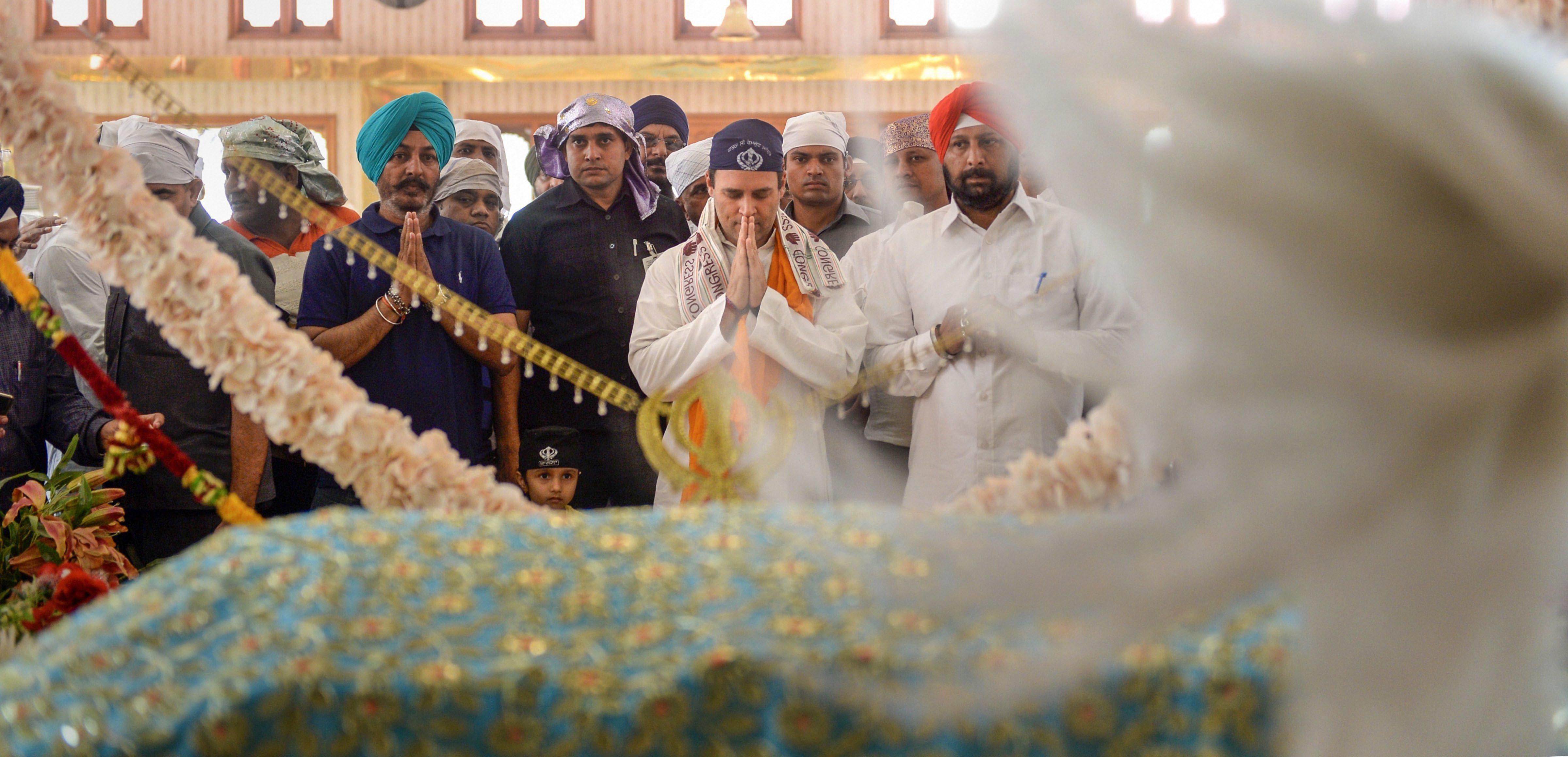 Congress chief Rahul Gandhi pays obeisance at a gurdwara  in Rajnandgaon on Saturday.