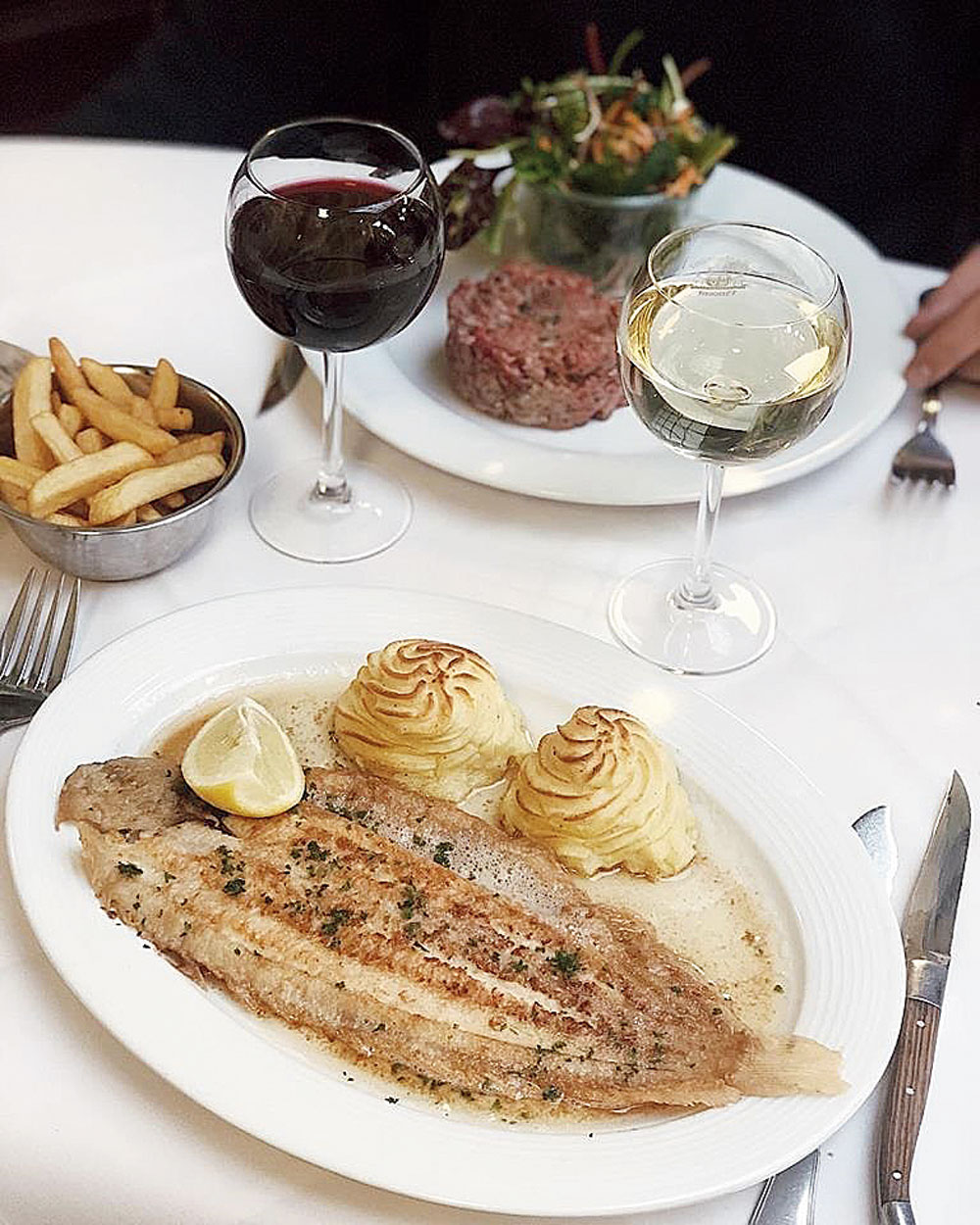 Sole Meuniere, Duchesse Potatoes and Tartare of Beef with fries at Chez Vincent