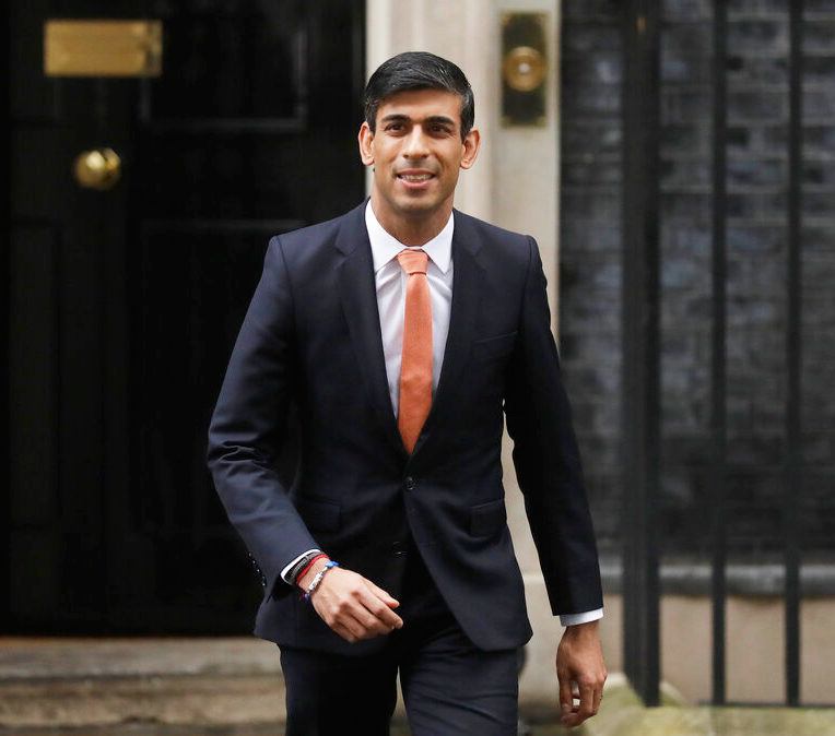 British lawmaker Rishi Sunak, and Chancellor of the Exchequer leaves 10 Downing Street, where he was given the job by Britain's Prime Minister Boris Johnson, as the former Chancellor Sajid Javid, resigned, in London, Thursday, February 13, 2020.