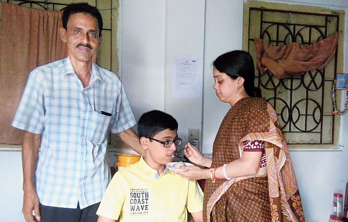 Topper Tathagata Roy with his parents.