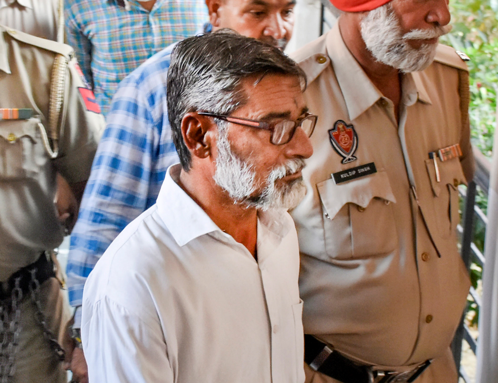 Kathua rape case main convict Sanjhi Ram being taken to the District and Sessions Court for the pronouncement of the quantum of punishment in Pathankot, Punjab, Monday, June 10, 2019.