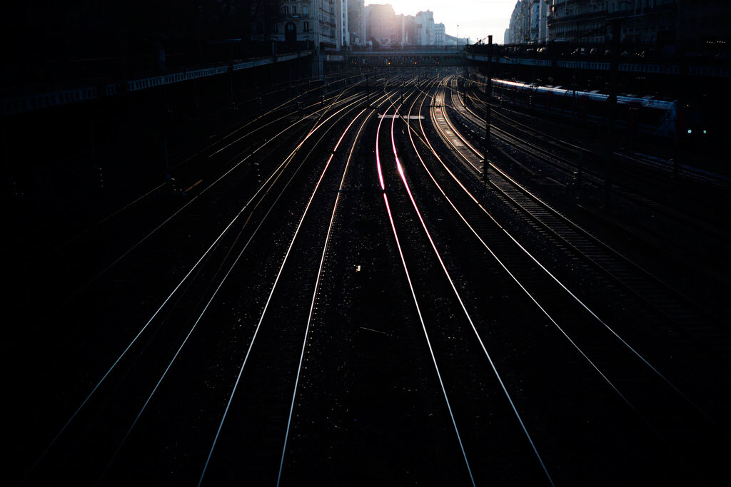 Empty railway tracks outside the Saint Lazare train station in Paris on December 31, 2019. The strikes over the French government's plan to revamp the retirement system have disrupted transport across France and beyond, hobbling Paris Metros and trains across the country as well as businesses.