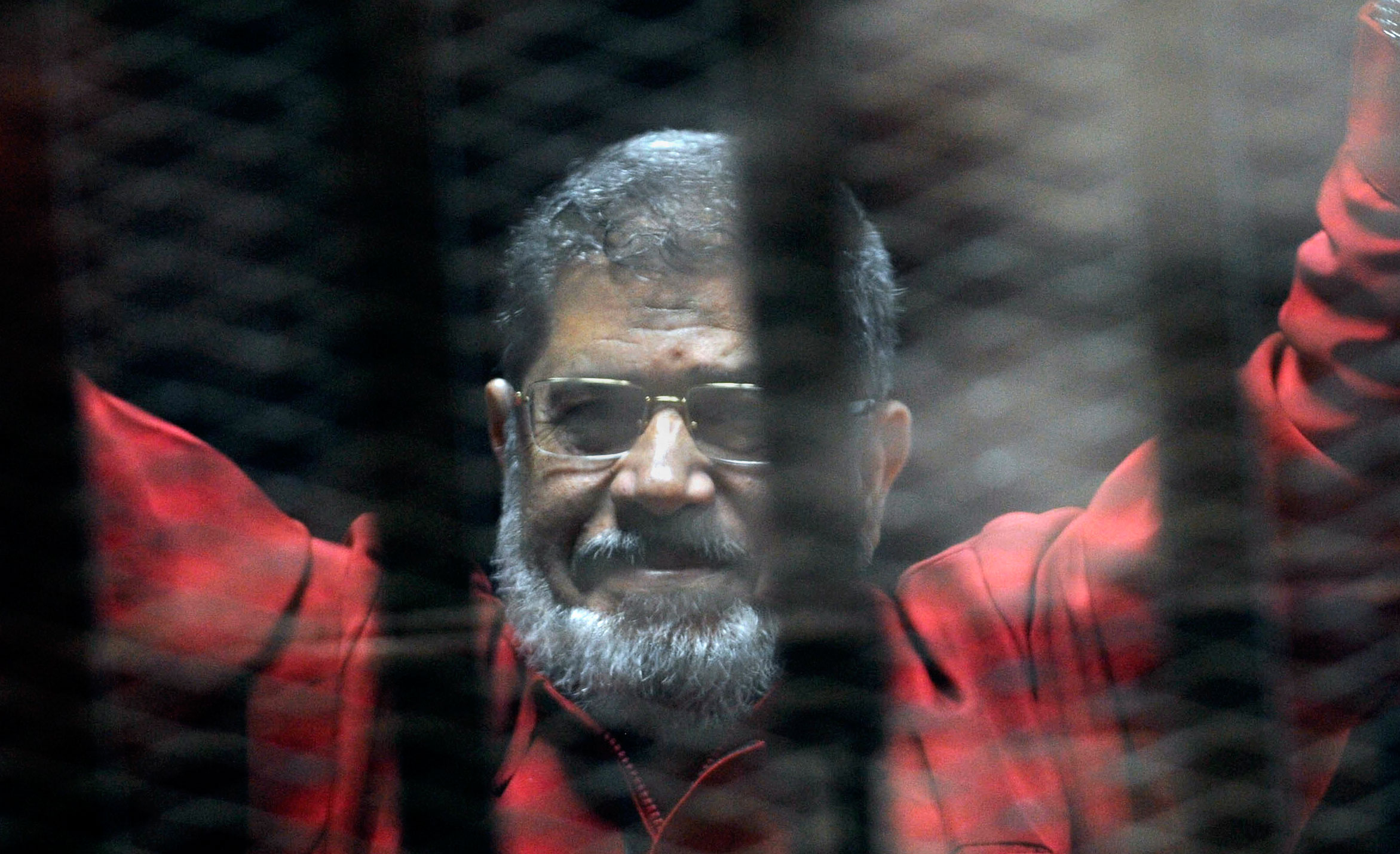 Egypt's ousted President Mohammed Morsi buried after death in courtroom