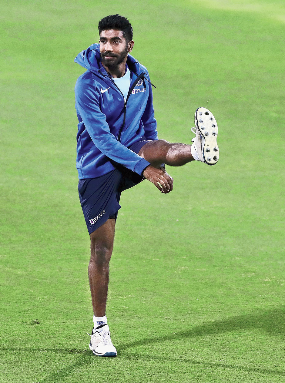 Jasprit Bumrah stretches during practice in Guwahati on Friday