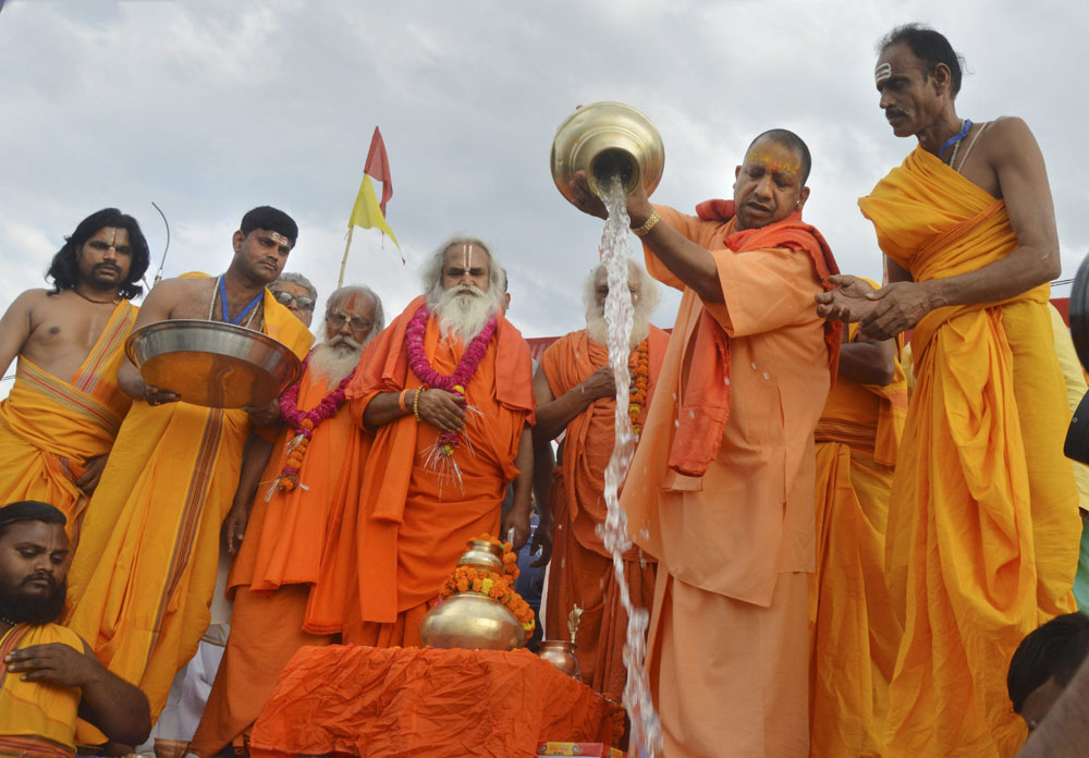 Uttar Pradesh Chief Minister Yogi Adityanath performs rituals at the bank of Sarayu river, in Ayodhya, Wednesday, April 17, 2019.