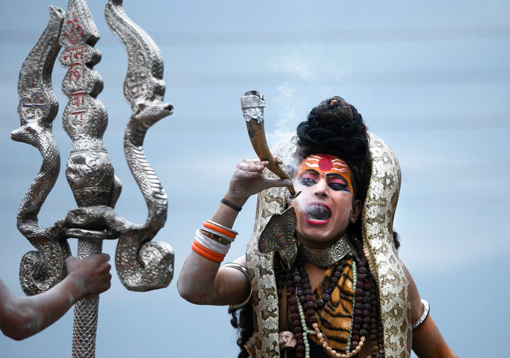 A devotee dressed as Hindu god Shiva participates in a procession on the eve of Shivratri festival in Jammu, Thursday, February 20, 2020.
