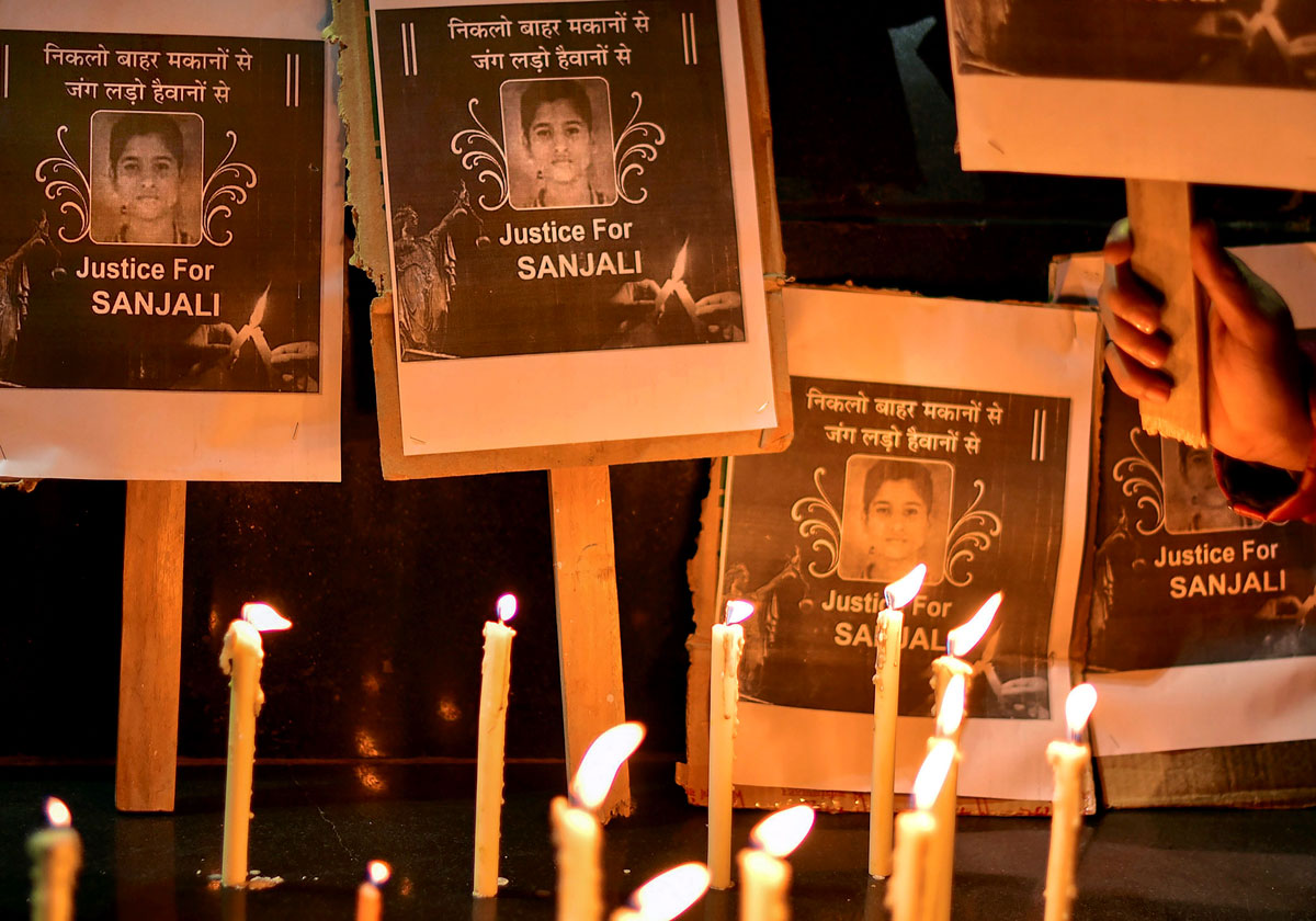 People take part in a candle light march demanding justice for Sanjali Chanakya, a fifteen-year-old who was burnt alive in Agra by two unidentified men, in Bikaner on December 23, 2018