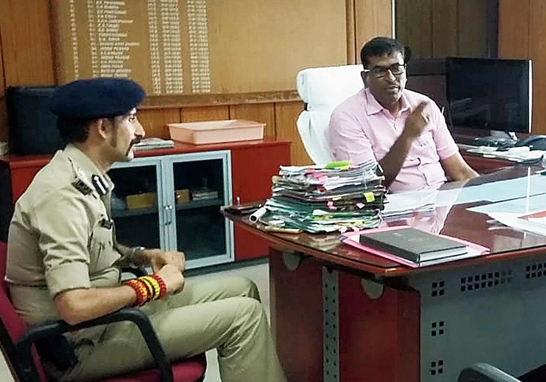 Patna DM Kumar Ravi and SSP Manu Maharaaj at the meeting on Thursday.