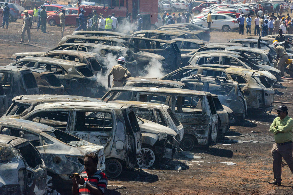 Gutted cars at the Bharati Nagar Gate parking area after a massive fire on the fourth day of the 12th edition of Aero India 2019, at Yelahanka Air Base in Bangalore on Saturday, February 23.