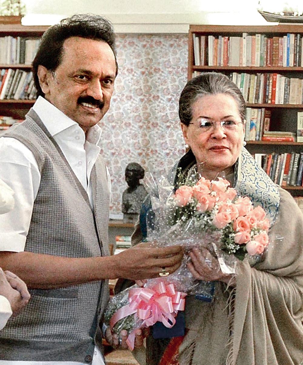 DMK president MK Stalin offers a bouquet to Sonia Gandhi on her birthday in New Delhi on Sunday.