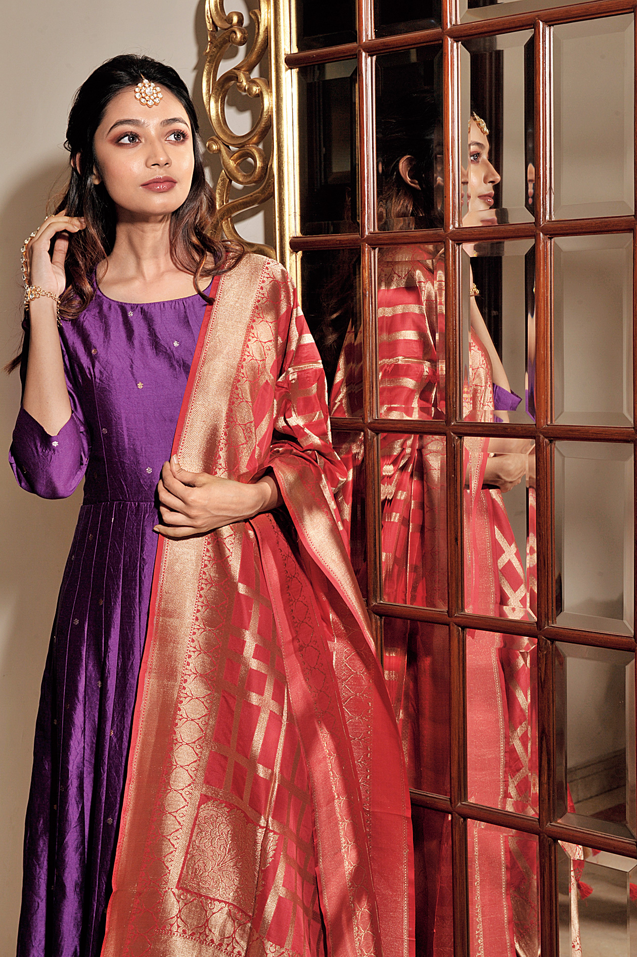 Violet vibe: Be it the puja at home or a family gathering, you can never go wrong with a classic anarkali. This ultraviolet anarkali with star bootis looks striking when paired with a red dupatta with an unconventional geometric pattern. If you want to dress it down, go for a dupatta in a more subdued hue. Kundan haathphool and maangtika make the look apt for Diwali