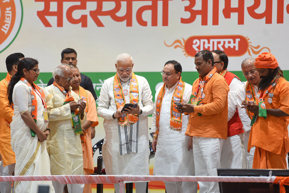 """Prime Minister Narendra Modi with BJP leaders at the launch of the membership drive in Varanasi on July 6. Modi dismissed critics of his government's target of a five-trillion-dollar economy in five years as """"professional pessimists"""""""