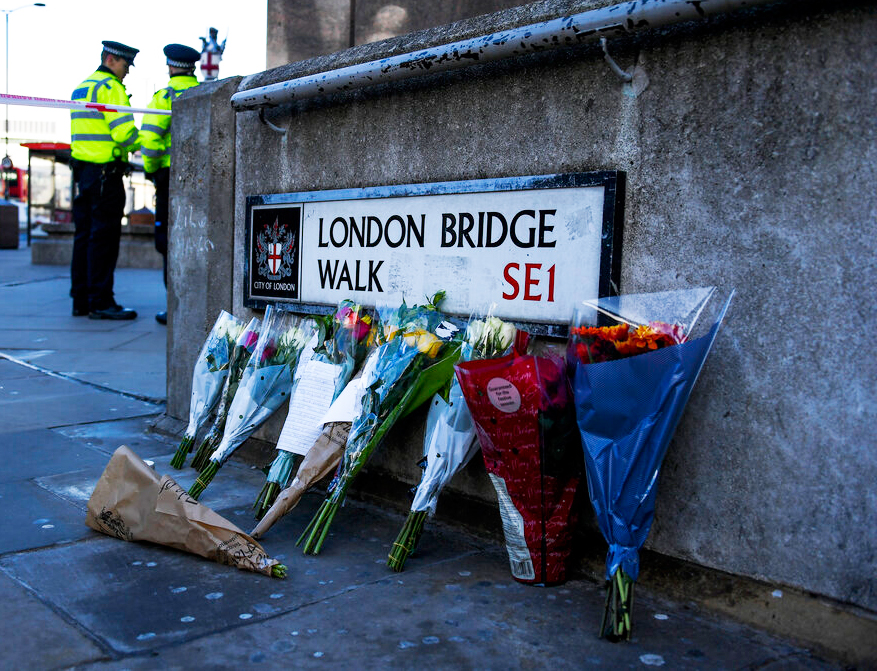 Flowers are left following Friday's terror attack on London Bridge in London, Sunday, December 1, 2019.