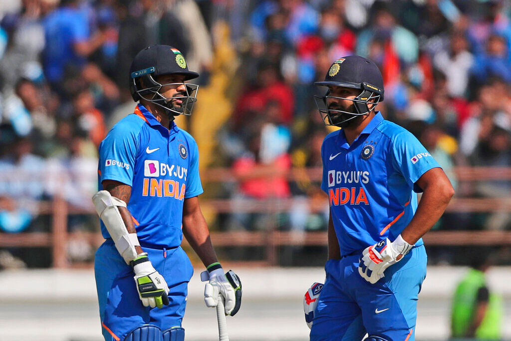 India's Shikhar Dhawan, left, and Rohit Sharma talk during the second one-day international cricket match between India and Australia in Rajkot on Friday
