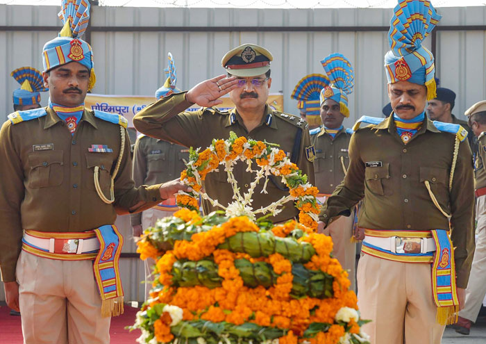 Central Reserve Police Force (CRPF) officers lays a wreath on the coffin of CRPF constable Ramesh Ranjan; who was killed during a gun-battle with terrorists at Parim Pora area of Kashmir; during a tribute paying ceremony at the Jaiprakash Narayan Airport in Patna, on Thursday