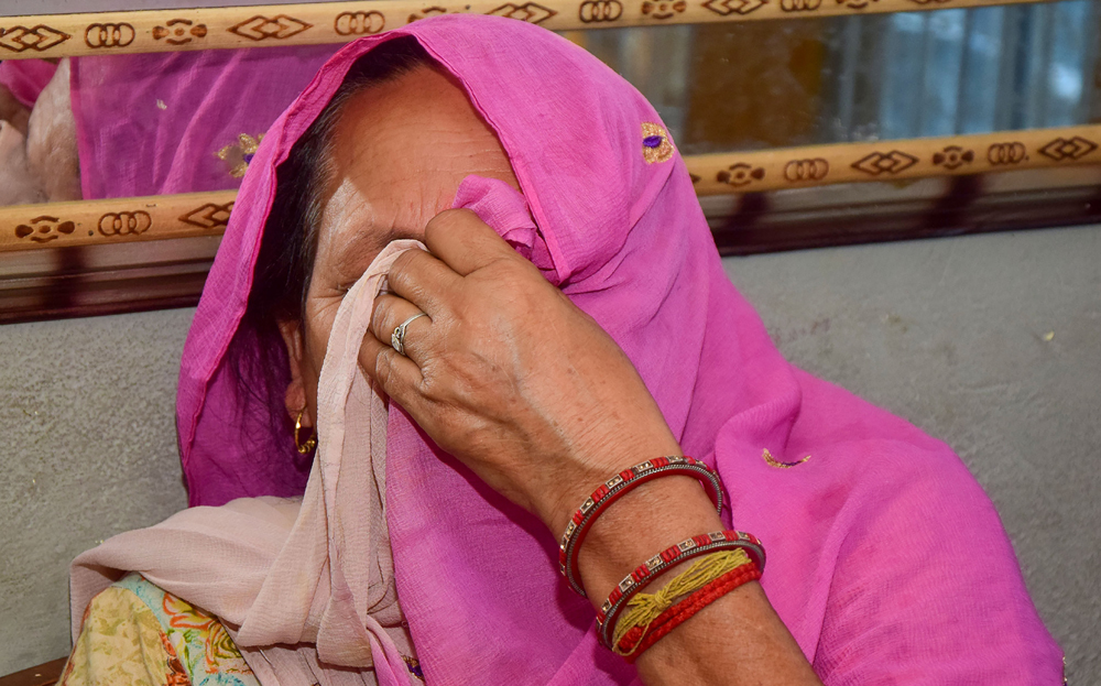 Darshana, wife of the main convict Sanjhi Ram who has been awarded with the life term in the Kathua case, reacts on the court verdict in Rasana village in Kathua, Monday, June 10, 2019
