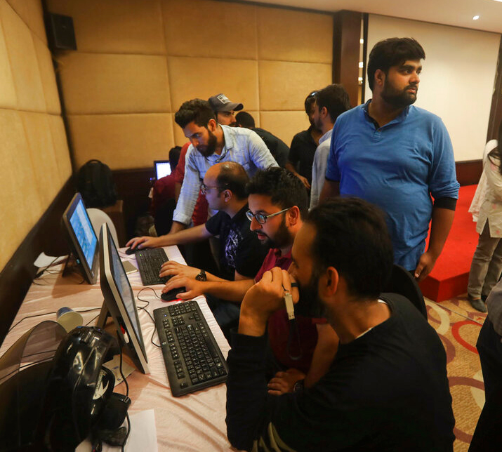 Journalists work in a media center set up by Jammu and Kashmir authorities in Srinagar on Sunday, August 18, 2019. Surely the Narendra Modi government has nothing to fear? Its high moral and nationalistic ground should leave it unperturbed by whatever may be reported from there