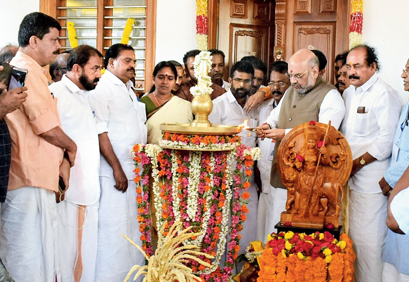 Amit Shah inaugurates the BJP's new district office in Kannur on Saturday.