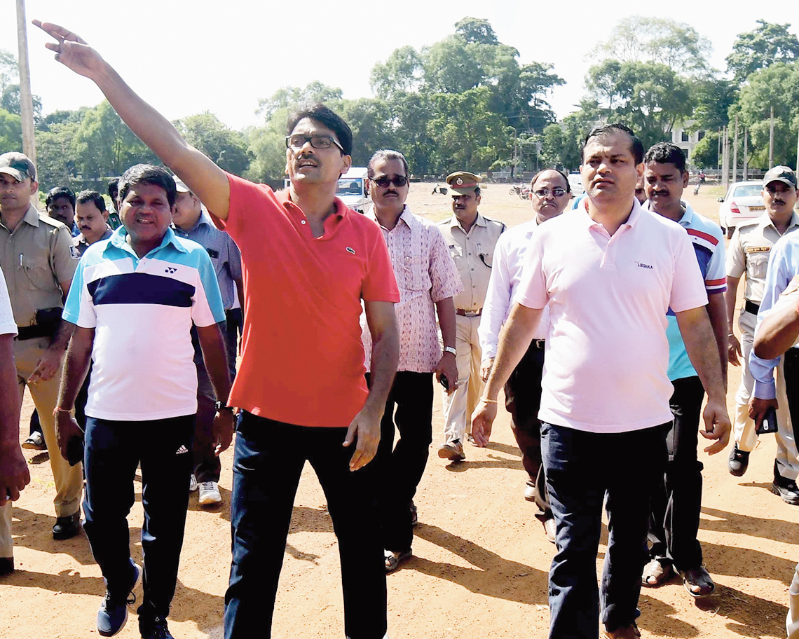 Deputy commissioner of police Akhileswar Singh (in red t-shirt) and (extreme right) collector Arvind Agarwal inspect the Bali yatra ground in Cuttack on Saturday.