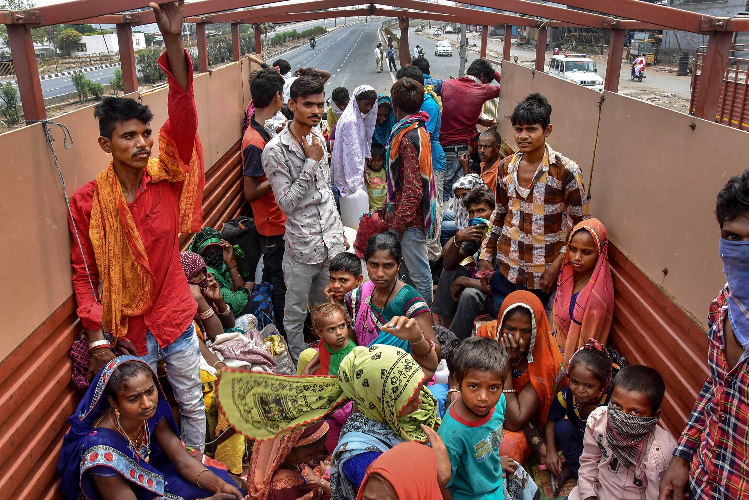 Migrant workers board a truck to return to their villages after the 21-day nationwide lockdown was imposed by the government in Surat on Thursday.