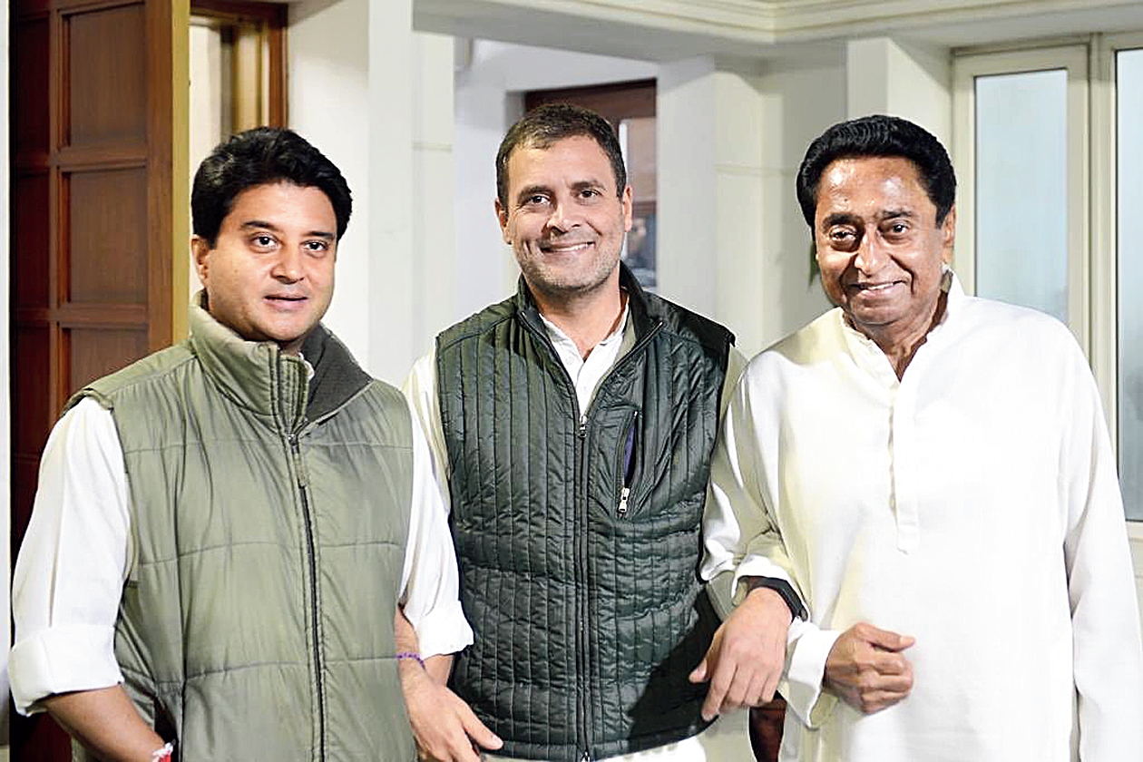 """Arms interlinked, Rahul Gandhi poses with Jyotiraditya Scindia (left) and Kamal Nath in a picture tweeted by the Congress president on Thursday evening. Along with the picture, Rahul tweeted a quote of Leo Tolstoy: """"The two most powerful warriors are patience and time."""""""