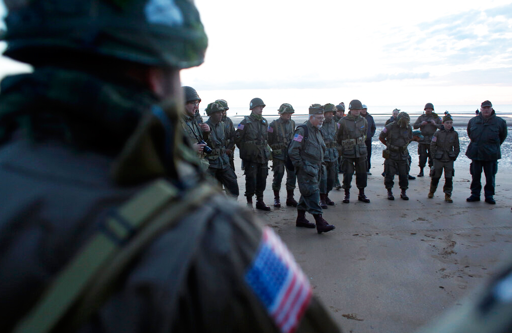 World War II re-enactors from Switzerland gather at dawn on Omaha Beach, in Normandy, France, Thursday, June 6, 2019 during commemorations of the 75th anniversary of D-Day.