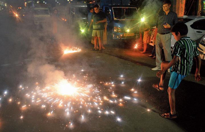 A firecracker on APC Road on Sunday evening