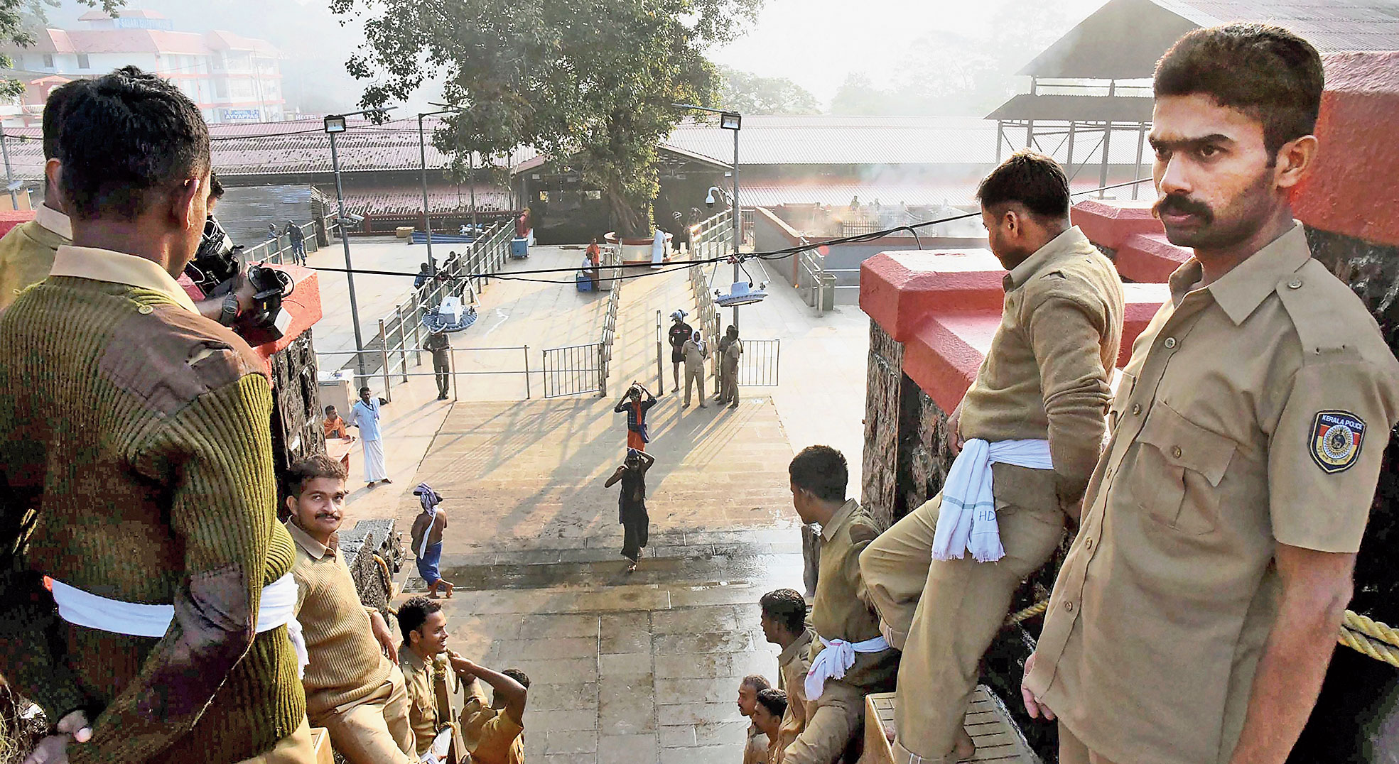 Police personnel on the 18 sacred steps of the Sabarimala temple on Sunday.