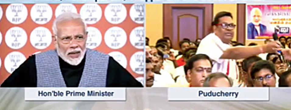 NaMo app footage shows Modi and Nirmal Kumar Jain (right, standing)