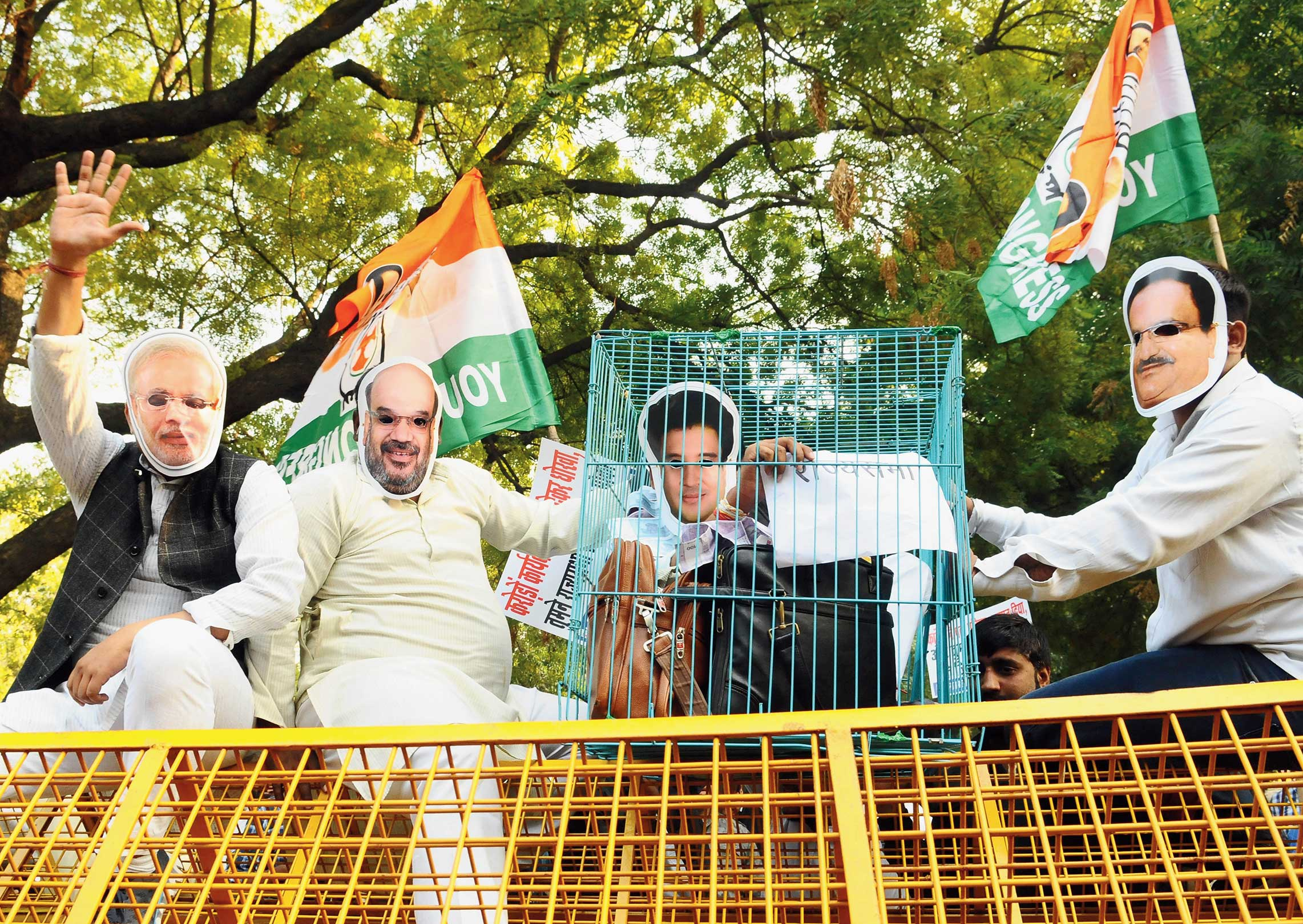 Youth Congress workers in masks protest alleged horse-trading by the BJP near Parliament on Wednesday. The protesters wear masks of Jyotiraditya Scindia, seen in a cage along with bags of money, and BJP leaders Narendra Modi, Amit Shah and JP Nadda.