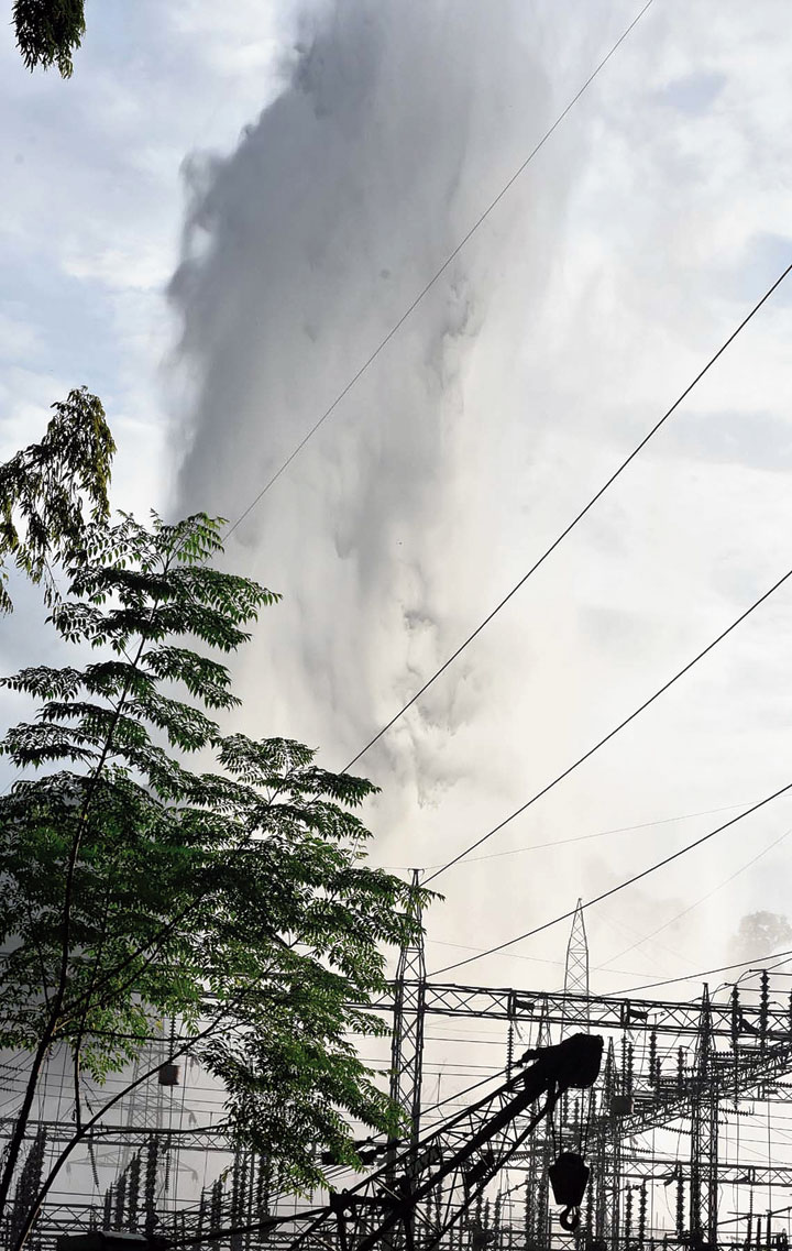 Water gushing out from the burst pipeline