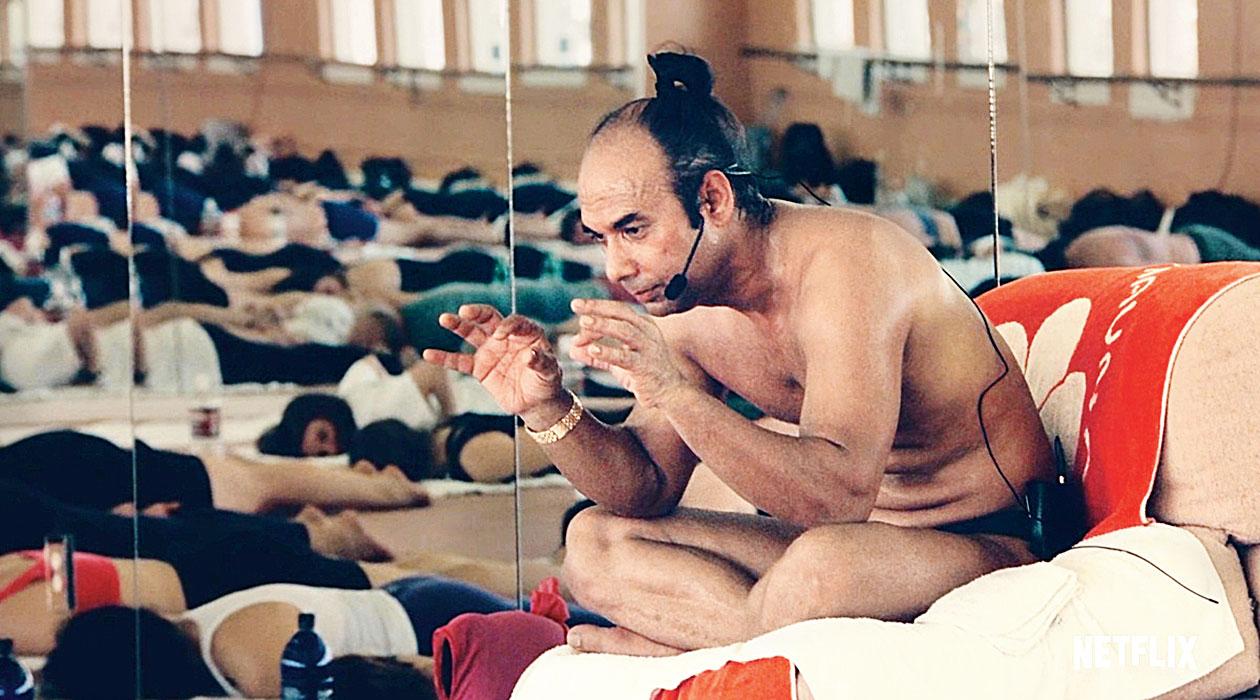 A moment from Bikram: Yogi, Guru, Predator