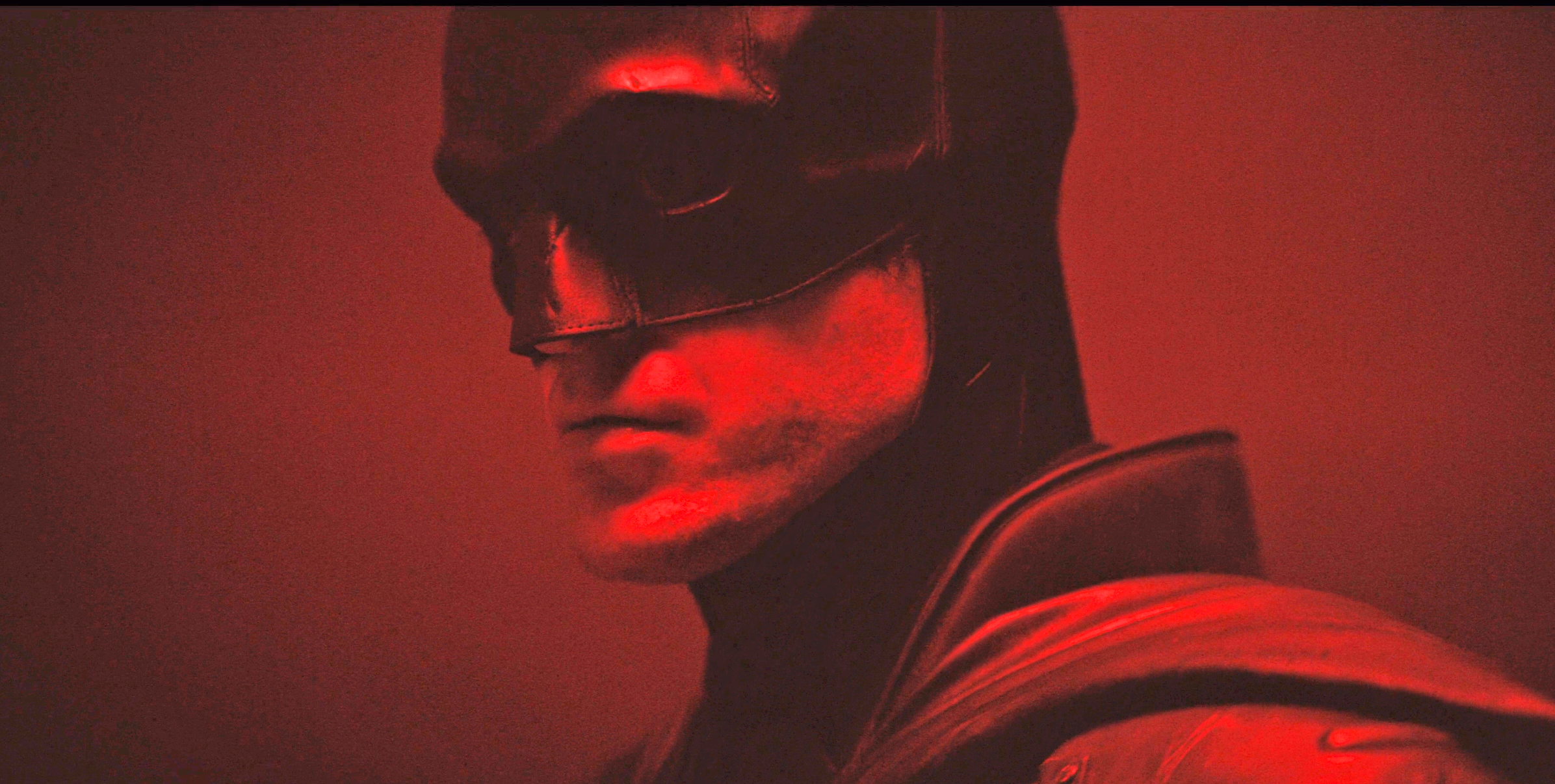 In the short clip, Robert Pattinson — dressed as the Caped Crusader — is approaching towards the camera that is set in a dark room saturated in red light.
