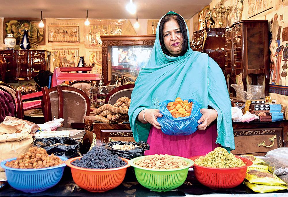 Hanan Shams of Abu Dhabi holds up apricots.