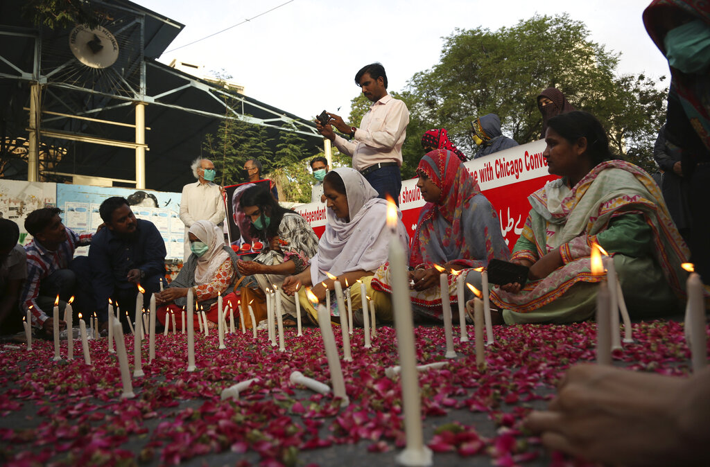 People attend candlelight vigil for victims of the crash of a state-run Pakistan International Airlines plane, in Karachi, Pakistan, Thursday , May 28, 2020.