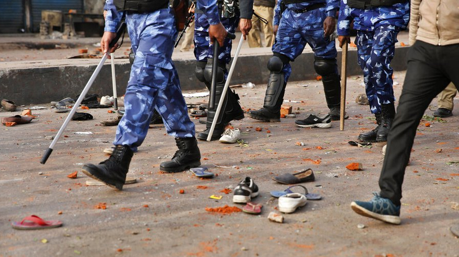 Policemen return after baton charging protesters during protests against CAA in Lucknow on December 20, 2019.