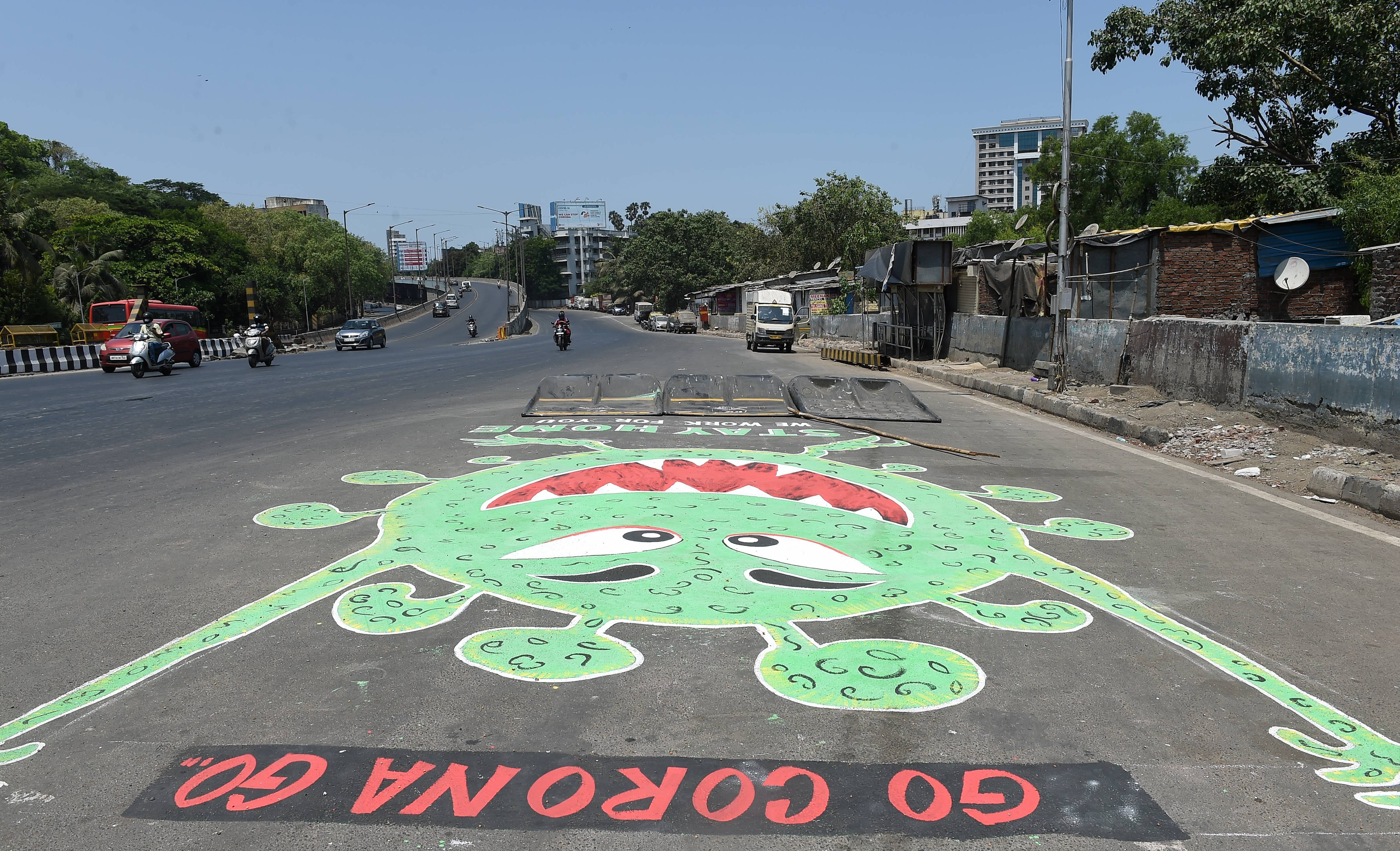 A street art resembling coronavirus is seen near Sasson Docks, during the ongoing nationwide lockdown as preventive measure against Covid-19, in Mumbai, Tuesday, May 12, 2020.