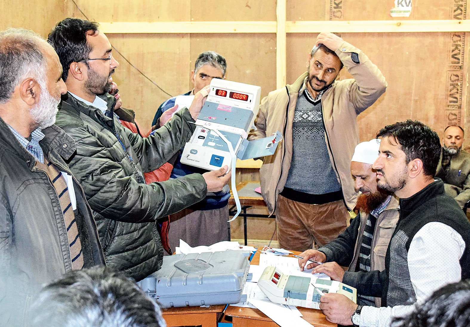 Polling staff count the votes in Srinagar on Saturday.