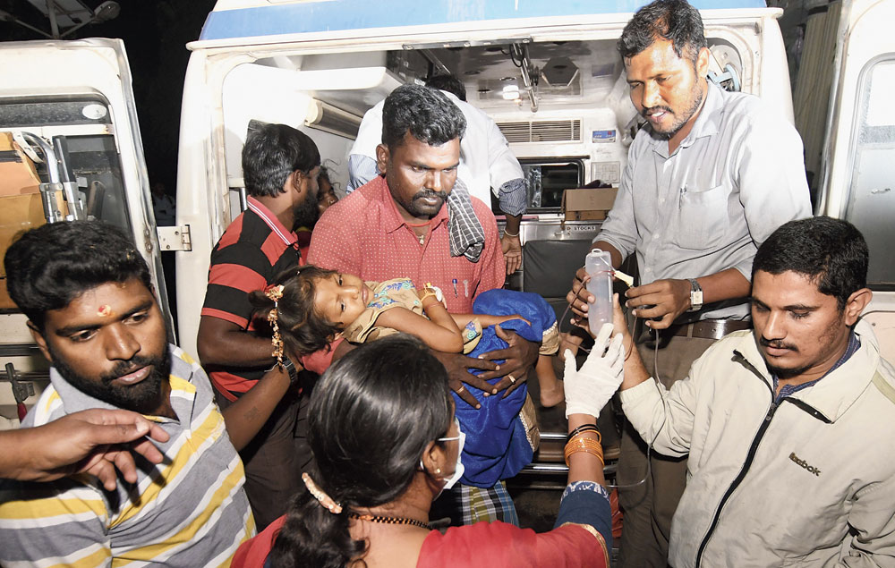 A girl who had consumed the poisoned temple offering being brought to a Mysore hospital on Friday.