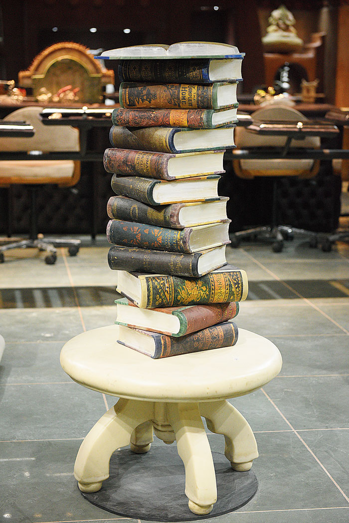 A stack of real books? Nah! It's an installation made of marble and various stones like green-blue fluorite, sillimanite, green aventurine, blue aventurine, blue opal, blood stone, yellow jasper and butter jade, that took more than two-and-a-half years to finish.