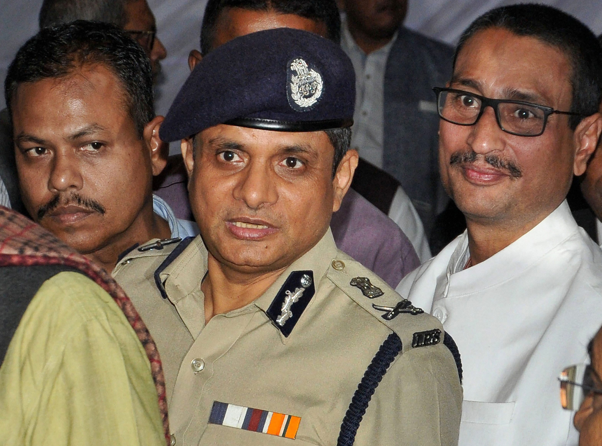 Calcutta Police Commissioner Rajeev Kumar (center) leaves the venue of West Bengal Chief Minister Mamata Banerjee's sit-in in Calcutta on Tuesday.
