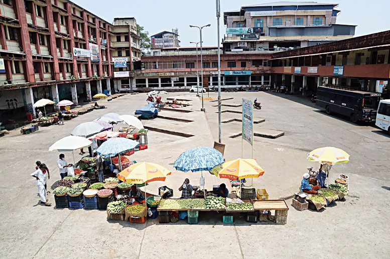 Vendors sell vegetables at a  bus stand in Kozhikode on Friday.