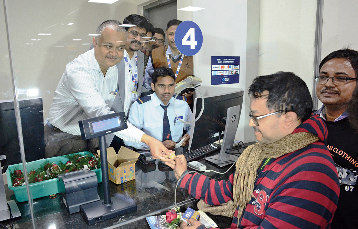 Rajib Roy of AC Block buys the first ticket of the East West Metro on Friday.