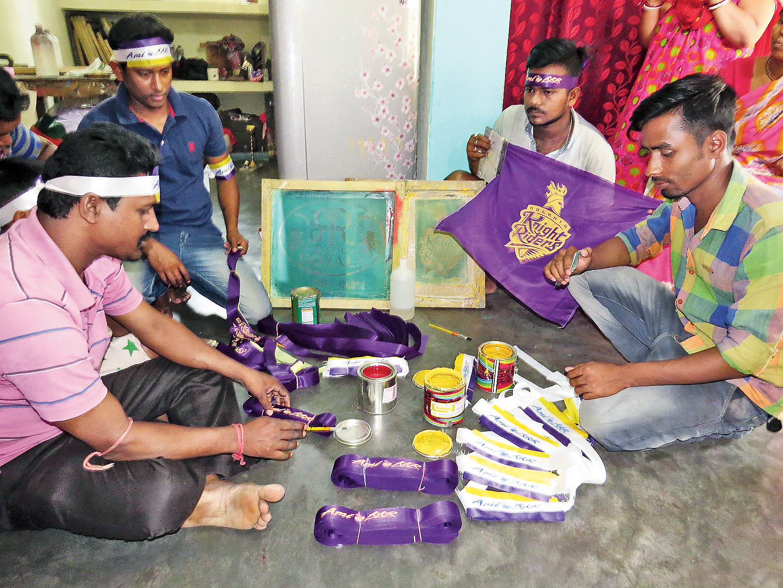Boys in Yogendranagar ready fan gear before heading out to the Eden Gardens on match day.