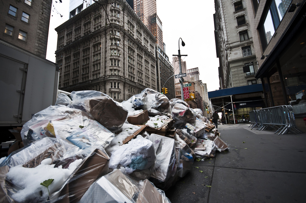 Garbage bags on the pavement in New York City. One person's trash is another person's treasure