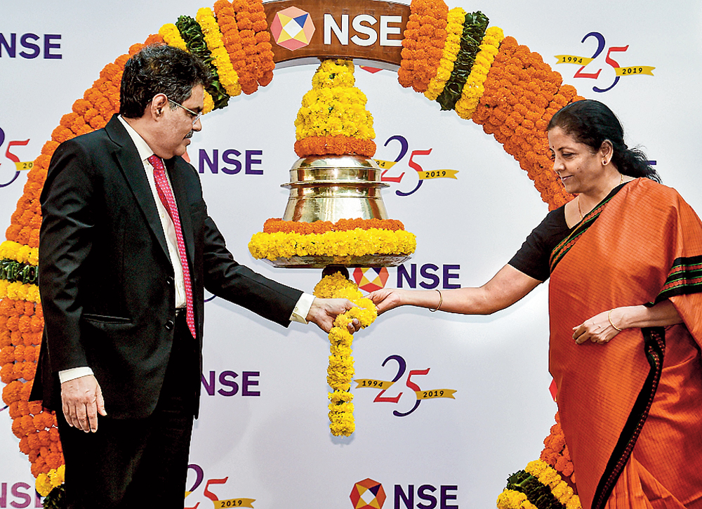 Nirmala Sitharaman and Sebi chairman Ajay Tyagi ring a bell to conclude the silver jubilee celebrations of the NSE in Mumbai on Tuesday