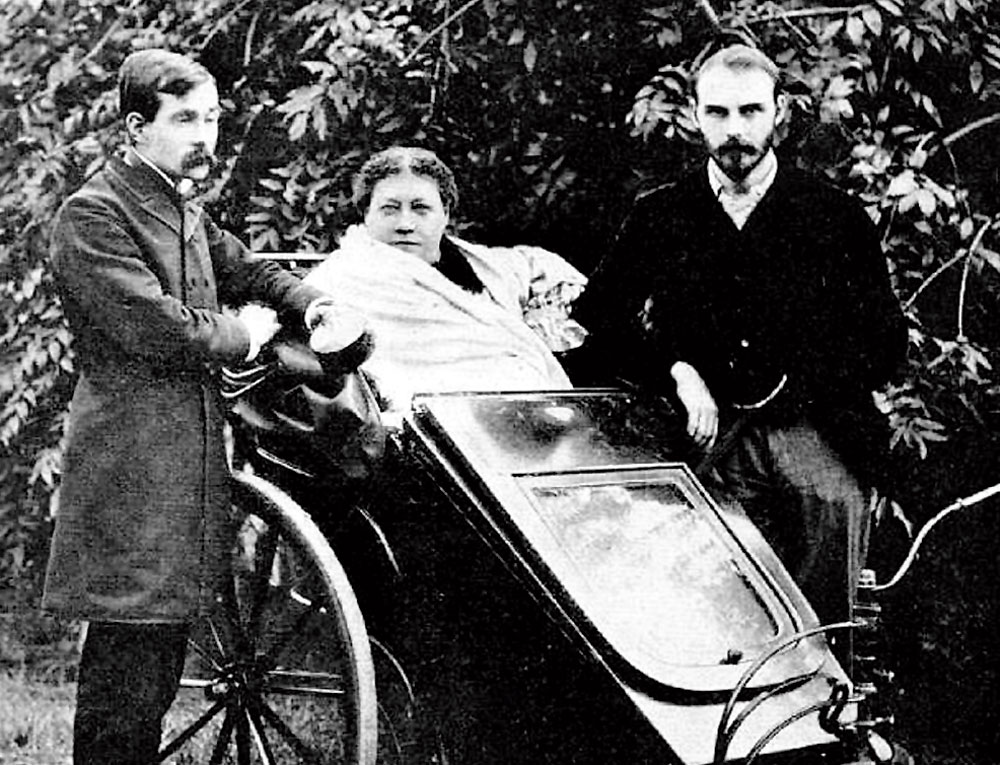 Helena Petrovna Blavatsky (seated), with James Morgan Pryse and George Robert Stow Mead in London 1890