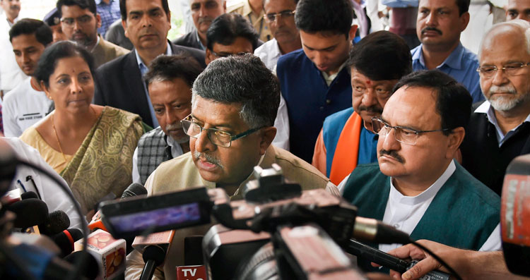 BJP leader Ravi Shankar Prasad addresses the media after a meeting with the Election Commission of India in New Delhi on Wednesday.