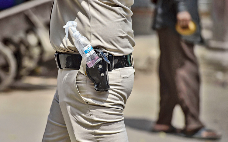 A policeman with a hand sanitiser in his holster at Khari Baoli in New Delhi on Sunday.