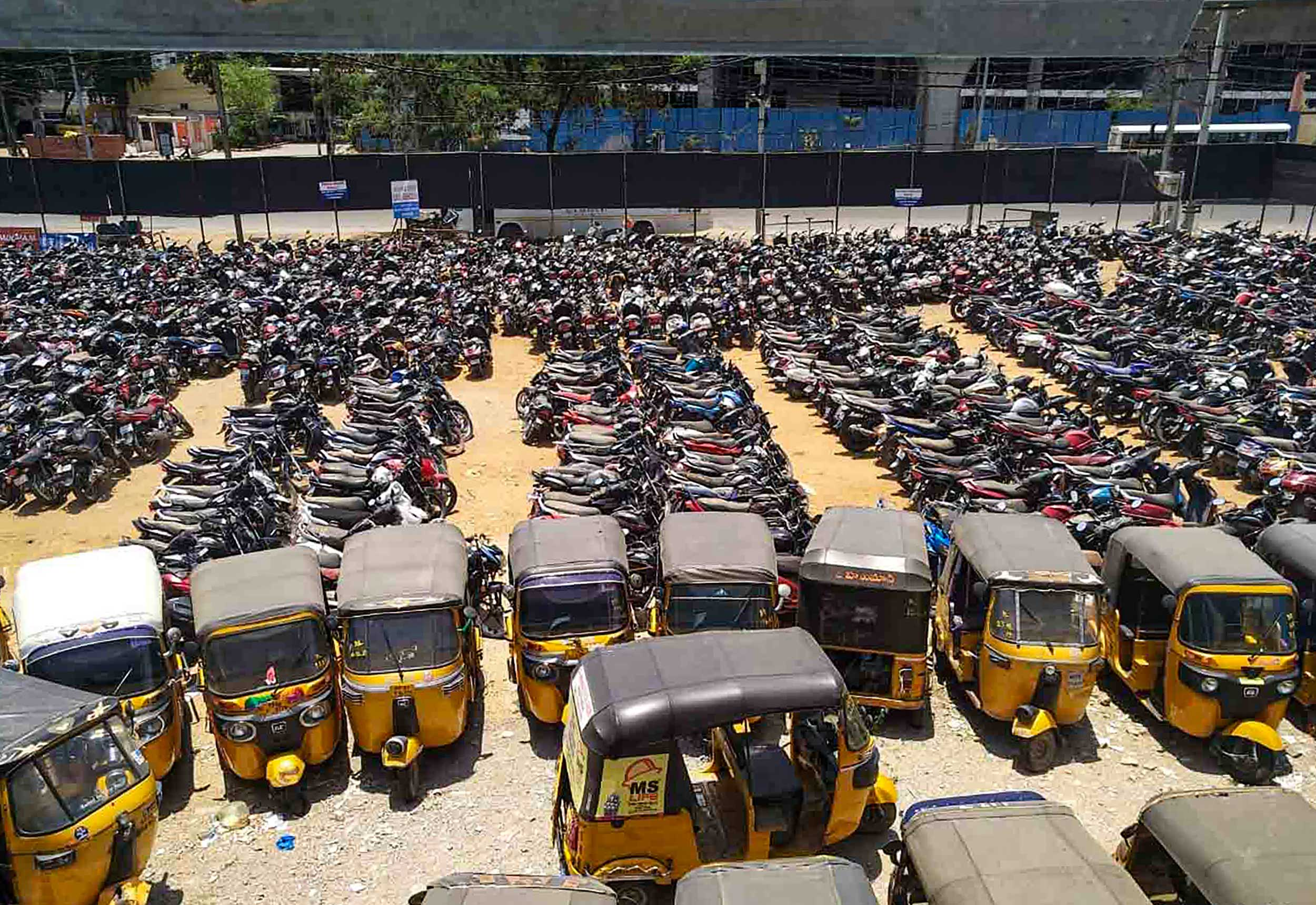Auto-rickshaws are seen parked during the nationwide lockdown at Moinabad in in Telangana's Ranga Reddy district on Saturday.